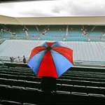 Wimbledon spectator with umbrella