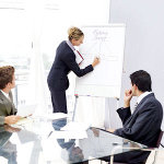 Business meeting with flip chart