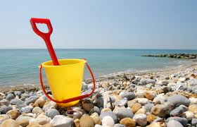 Bucket and spade on a pebble beach