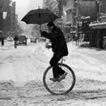 Man riding a unicycle in the snow